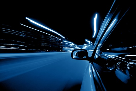 car fast drive on highway in night photo