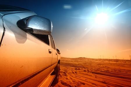 the desert: truck in desert sand and blue sky