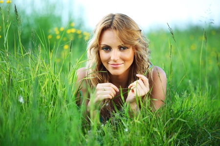woman on the green grass happy and smile Stock Photo - 9287554