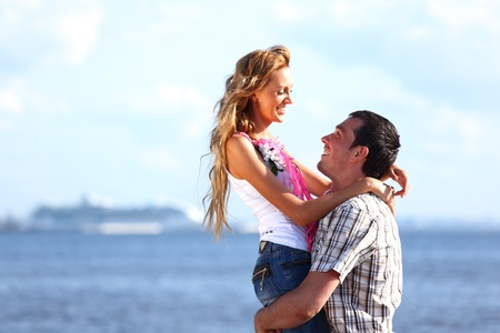 man and woman hug in the sky and sea on sea Stock Photo - 9289150