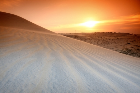 arabic desert: desert sand under sunset sky Stock Photo