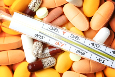thermometer and drugs medical background Stock Photo - 9411688