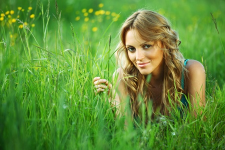 blonde lays on green grass Stock Photo - 9596760