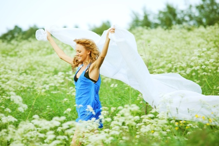 girl run by field fabric in hands fly behind like wings Stock Photo - 9596765
