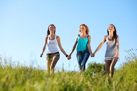 fun smile girlfriends run by green field sun is shine Stock Photo - 9596769