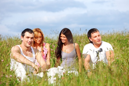 friends and dog in green grass field Stock Photo - 9706805