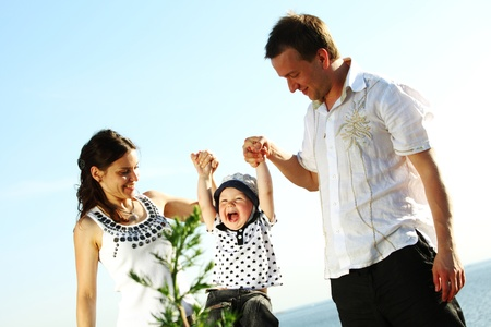 happy family blue sky on background Stock Photo - 9877215