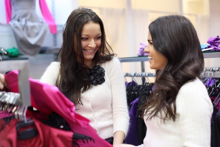 woman in shop look at clothes photo