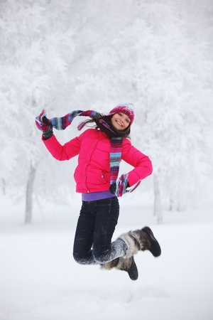 winter women jump in snow photo
