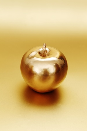 gold apple on gold background Stock Photo