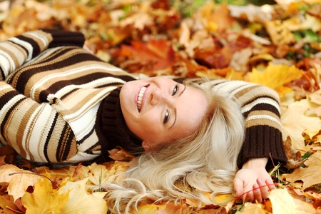 woman portret in autumn leaf close up Stock Photo - 9861847