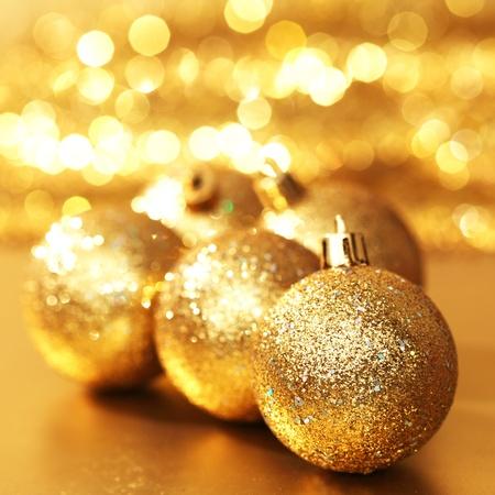golden christmas ball on golden bokeh background photo
