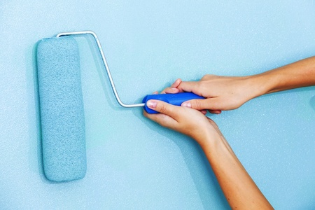 woman paints the wall roller Stock Photo - 9854842