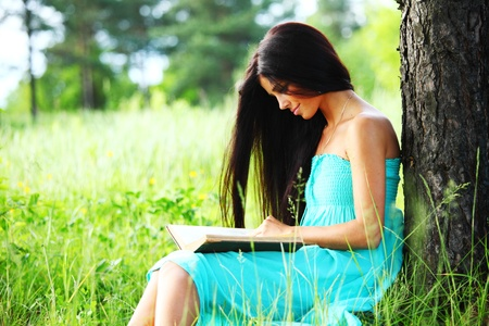 girl with book under big tree photo