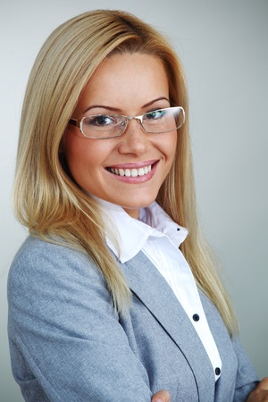 business woman in glasses on gray background Stock Photo - 9861670