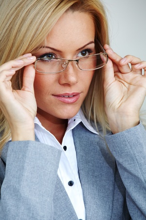 business woman in glasses on gray background Stock Photo - 9861667