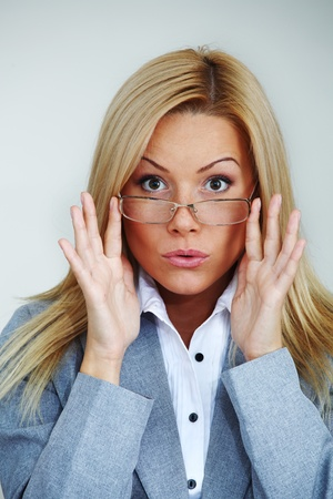 business woman in glasses on gray background Stock Photo - 9861573