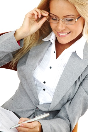 business woman hold a folder of papers  and write Stock Photo - 9861611
