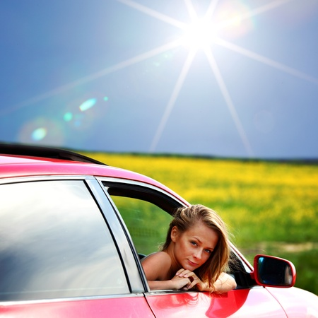 woman in red car get out window Stock Photo - 9861887
