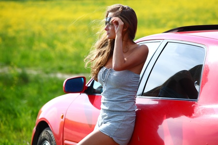 woman in red car get out window Stock Photo - 9861946