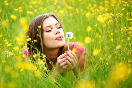 wish: summer woman blow on dandelion