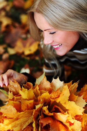 woman portret in autumn leaf close up Stock Photo - 9861730
