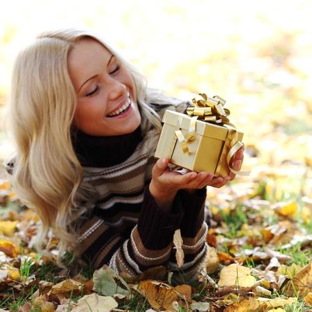 woman take autumn gift in park Stock Photo - 9862221