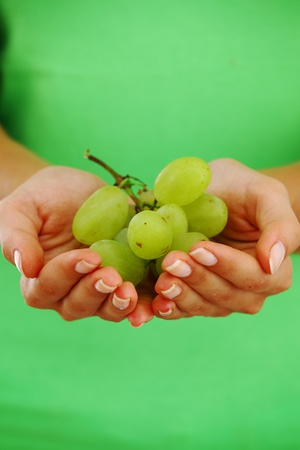grape in woman hands close up photo