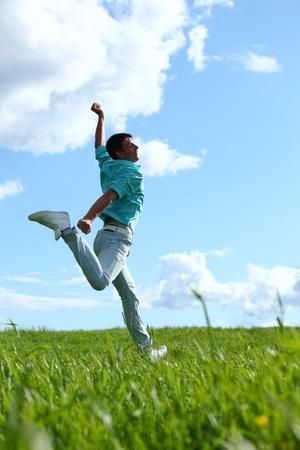 positivity: man jump in the blue sky