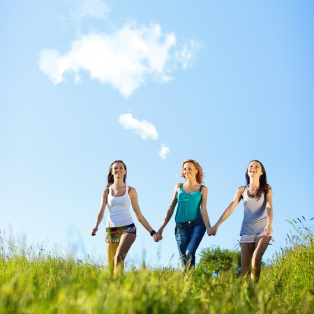 fun smile girlfriends run by green field sun is shine Stock Photo - 9861978