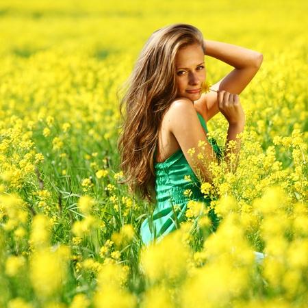 woman on oilseed field close portrait Stock Photo - 9862139