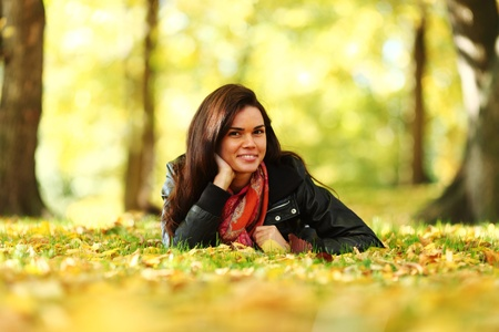 woman portret in autumn leaf close up photo
