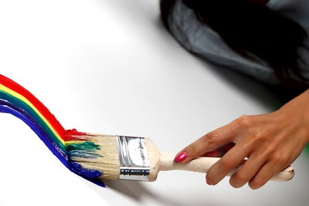 rainbow paint on the white wall photo