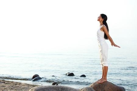 beach yoga: meditation on ocean sand beach