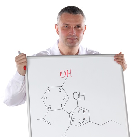 Chemistry teacher presenting formula of organic chemical compound Stock Photo - 9906755