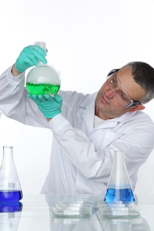 Chemistry Scientist conducting experiments on white background Stock Photo - 9906838