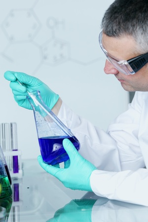 Chemistry Scientist conducting experiments in laboratory Stock Photo - 9906854