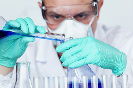 Chemistry Scientist conducting experiments in laboratory Stock Photo - 9906873