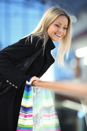 woman in shop center holds the bag in hands Stock Photo - 9906802
