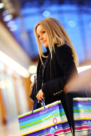 woman in shop center holds the bag in hands Stock Photo - 9906818
