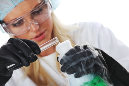 Woman  conducting a chemical experiment photo