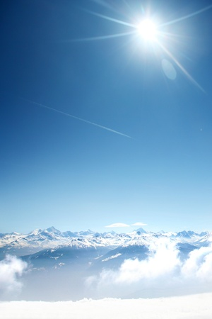 winter scenery: top of mountains sun in blue sky