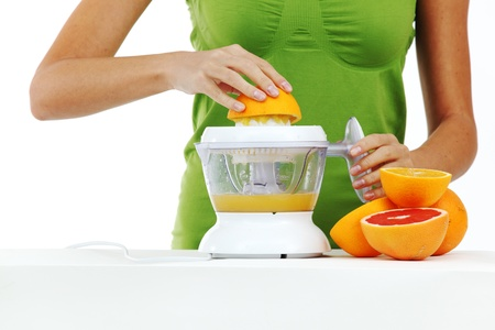 juicer: woman squeezes juice by juicer