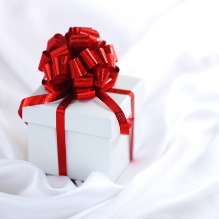 christmas gift on white silk background photo