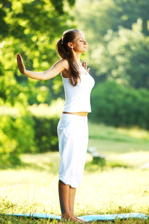 yoga woman on green park background Stock Photo - 9908111