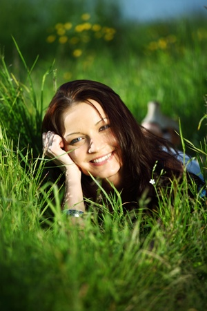 happy woman lay on green grass photo