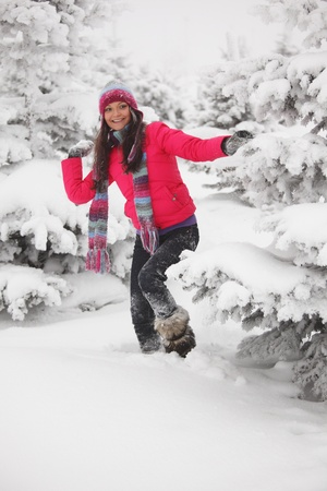winter woman play snowballs on snow background photo