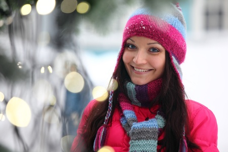 holyday: woman in winter hat and holyday bokeh