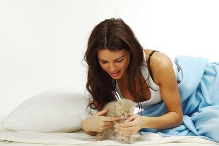 waking woman on the white pillow photo