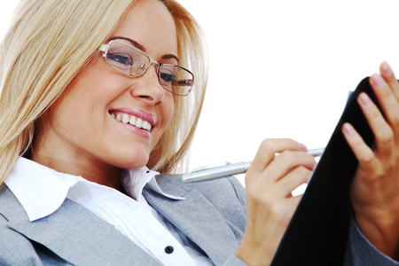 business woman hold a folder of papers  and write Stock Photo - 9961608